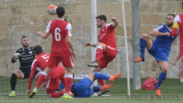 Several Balzan players scramble to secure the ball during their Premier League match against Mosta at Tedesco Stadium in Hamrun on January 9. Photo: Matthew Mirabelli