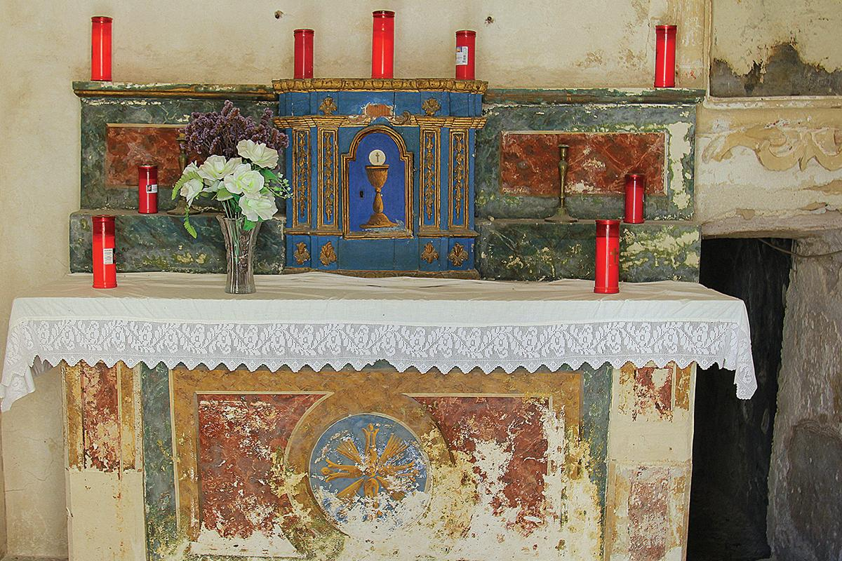 An altar in the abandoned chapel built at the place where San Guglielmo lived as hermit.
