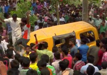 13 children killed when school bus and train collide in northern India