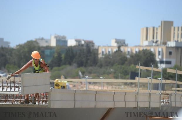 Workers lay the base of the road in the Kappara flyover on May 5. Photo: Matthew Mirabelli