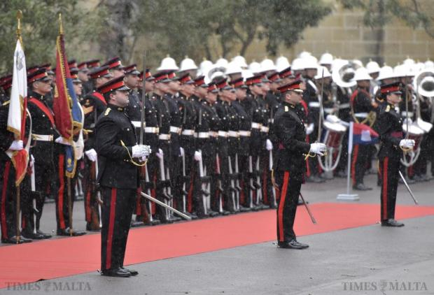 Armed Forces of Malta soldiers prepare for the arrival of Britain's Queen Elizabeth at San Anton Palace in Attard on November 26. Photo: Mark Zammit Cordina