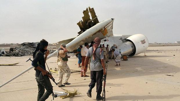 Southern Resistance fighters checking the wreckage of a destroyed Boeing 747 plane at the international airport of Yemen's southern port city of Aden yesterday. Photos: Reuters