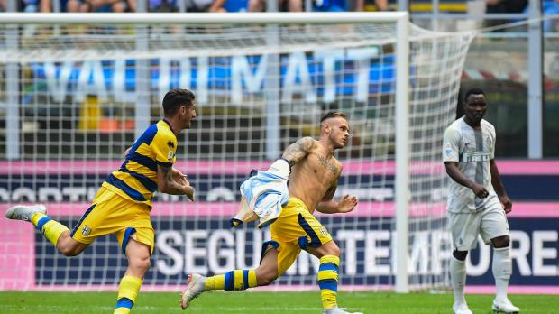 Federico Dimarco wheels away after scoring Parma's winner at the San Siro.