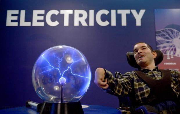 Antoine Grima places his hand on a plasma ball, one of the exhibits at the Esplora science centre in Kalkara, on the occasion that a memorandum of understanding was signed between the Malta Council for Science and Technology and the Parliamentary Secretariat for People with a Disability and the Elderly, on October 10. Photo: Matthew Mirabelli