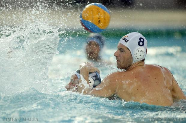 Neptunes' Jordan Camilleri (right) closely marks Sliema's Jerome Gabaretta during their waterpolo national league match at the National Pool in Tal-Qroqq on July 29. Photo: Darrin Zammit Lupi