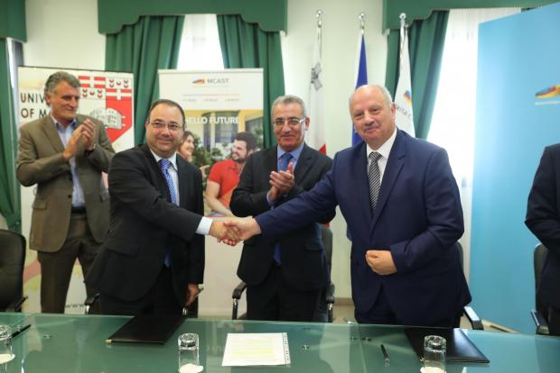 Education Minister Evarist Bartolo (centre) applauds as representatives of the two institutions seal the MoU. Photo: University of Malta