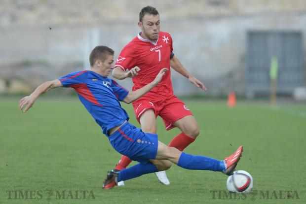 Malta's Ryan Camenzuli (right) is denied the ball by Moldova's Dinu Graur (left) during their UEFA U21 Championship group match at the Hibernians Stadium in Corradino on October 11. Photo: Matthew Mirabelli