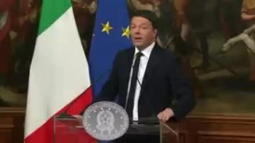 Renzi formally resigns, stays on as caretaker prime minister