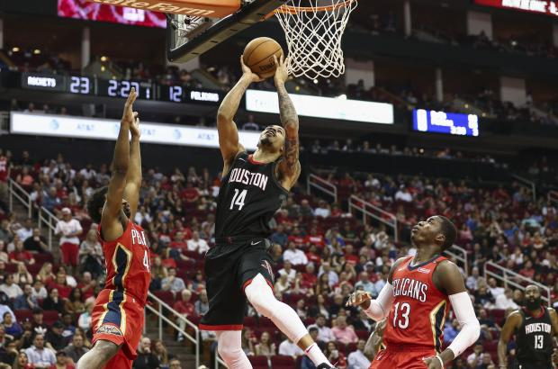 Houston Rockets guard Gerald Green (14) shoots the ball as New Orleans Pelicans forward Solomon Hill (44) defends during the first quarter at Toyota Center. Photo Credit: Troy Taormina-USA TODAY Sports