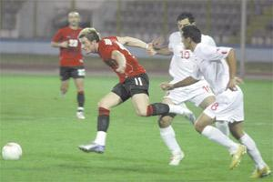 Albania`s Besart Berisha (left) powers his way past Malta`s Etienne Barbara (no.10) and Roderick Briffa during yesterday`s friendly in Tirana.