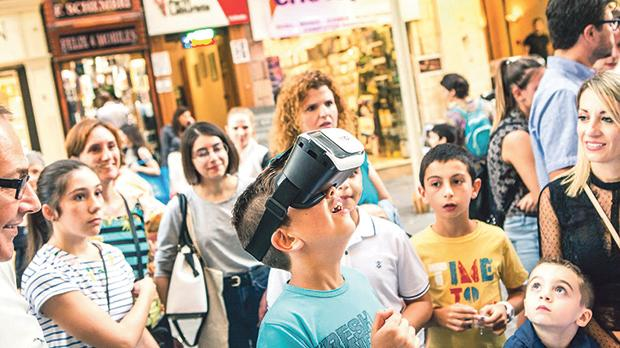 Children using a virtual reality headset and enjoying a show on explosive chemical reactions during a past edition of Science in the City in Valletta.