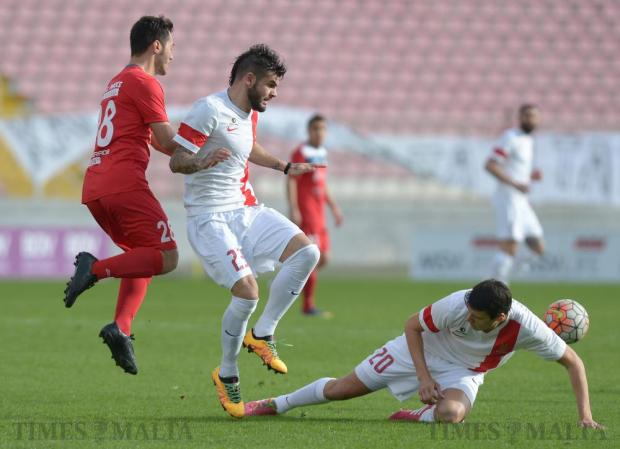 Valletta's Federico Falcone (right) clashes with team mate Claudio Pani (centre) denying Pembroke Athleta's Terence Agius the ball during their BOV Premiership match at the National Stadium in Ta'Qali on March 13. Photo: Matthew Mirabelli