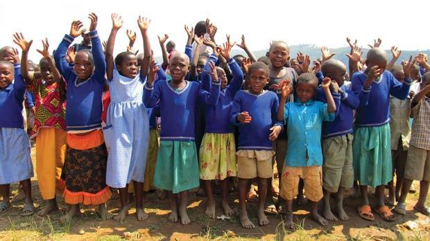 Big welcome by the students at Lake Bunyonyi school in Uganda.