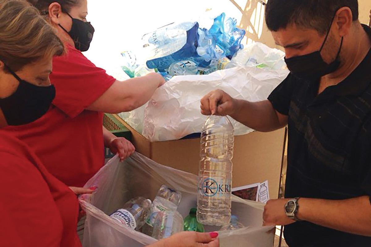 Staff at Laura Vicuna School sorting donated plastic bottles.