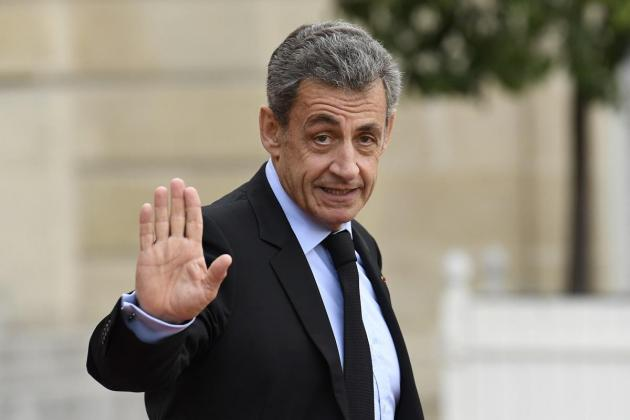 Former French president Sarkozy to stand trial for illegal campaign financing