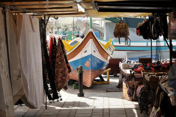 A 'Luzzu' 'looks' towards the Marsaxlokk market on March 7. Photo: Chris Sant Fournier