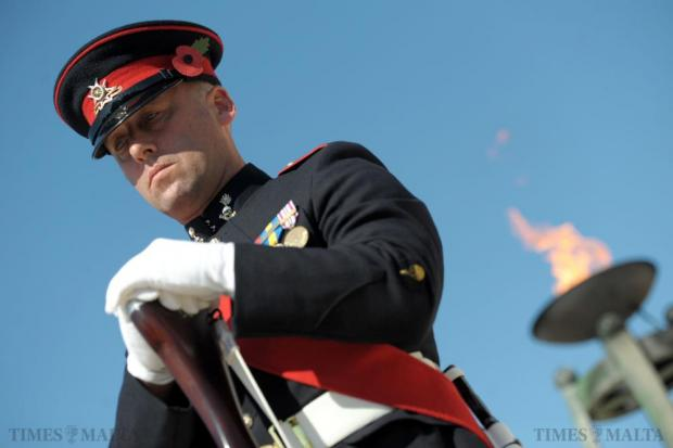 A soldier stands solemnly during the annual wreath-laying ceremony at the War Memorial in Floriana on November 8 as Malta joined its Commonwealth counterparts to remember those who perished in the two world wars. Photo: Matthew Mirabelli