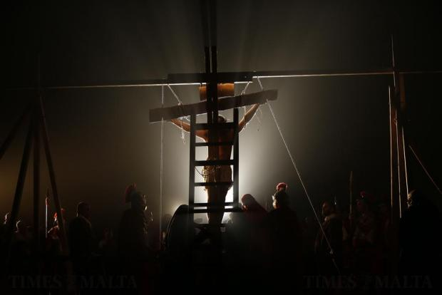 """Actors portraying a scene from the crucifixion of Christ take part in the interactive street-theatre Passion play """"Il-Mixja"""" (The Way), one of a series of Holy Week activities in the run-up to Easter, in the grounds of Mount Carmel Mental Hospital in Attard on March 22. Photo: Darrin Zammit Lupi"""