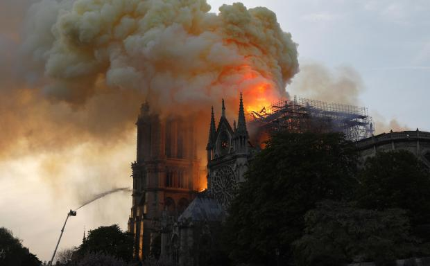 The Notre-Dame on fire.
