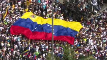 Rival rallies begin in tense Venezuela as air force general defects