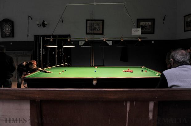 A snooker player takes aim at the La Valette Band Club in Valletta on December 20. Photo: Chris Sant Fournier