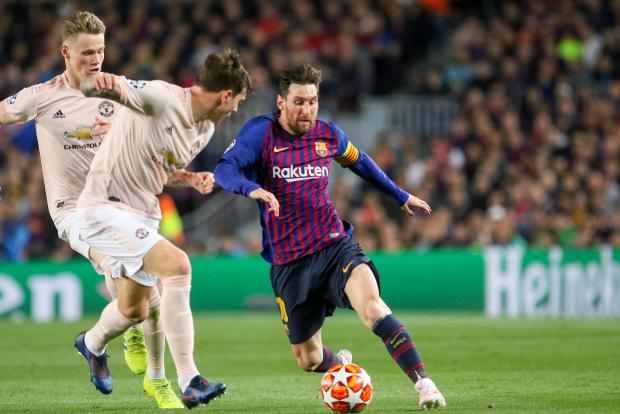 Lionel Messi (right) tore Man. United apart on Tuesday night.