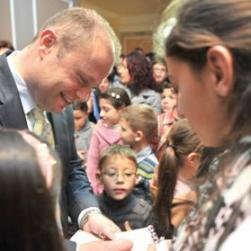 Labour leader Joseph Muscat signs autographs for children of Labour party volunteers during a visit to watch a 5D film about Malta's history at the City Theatre in Valletta on the campaign trail yesterday. Photo: Jason Borg