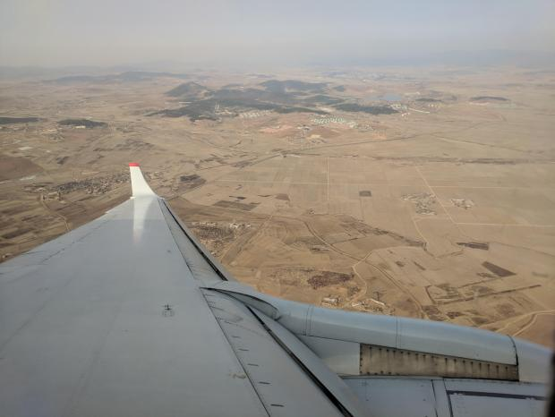 A photo taken on Febraury 12, 2019 shows a general view of the landscape and farmland north of Pyongyang from the window of an aircraft.