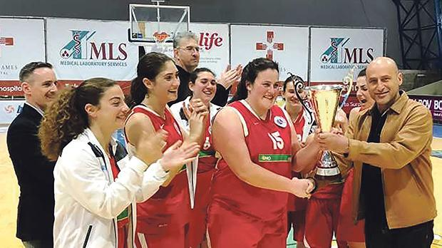 The Luxol players celebrate after receiving the trophy from MBA president Paul Sultana.