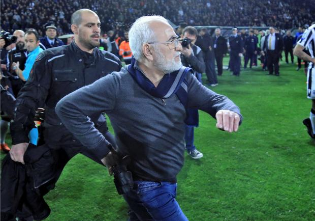 Russian-born Greek businessman and owner of PAOK Salonika, Ivan Savvides , pictured with what appears to be a gun in a holster.