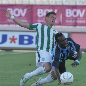 Sliema's Stanley Ohawuchi (right) tripped by Ferencvaros defender Philipp Bonig during the first leg at Ta' Qali. Photo: Jason Borg