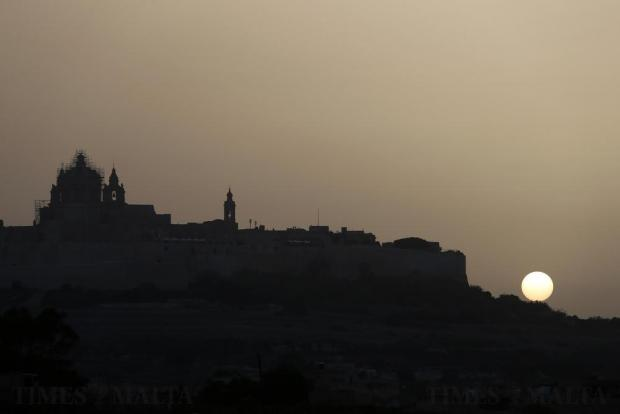 The sun sets behind Mdina on October 3. Photo: Darrin Zammit Lupi