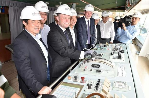 Joseph Muscat with Konrad Mizzi and Keith Schembri (third from right) during the sailing away ceremony of the LNG tanker
