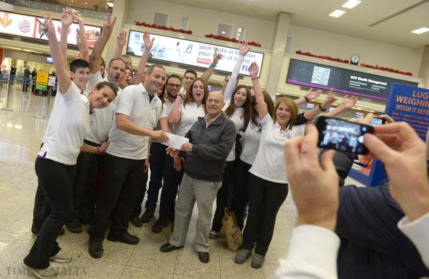 Participants of the Kilimanjaro Challenge present a cheque containing the last installment of the €65,000 which they raised for a kindergarten in Ethiopia before leaving to climb Mount Kilimanjaro, at Malta International Airport, Gudja on December 27. Photo: Matthew Mirabelli