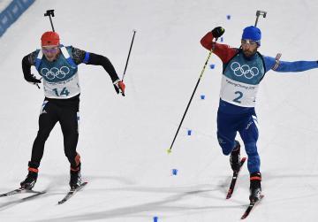 Fourcade wins biathlon to make French record