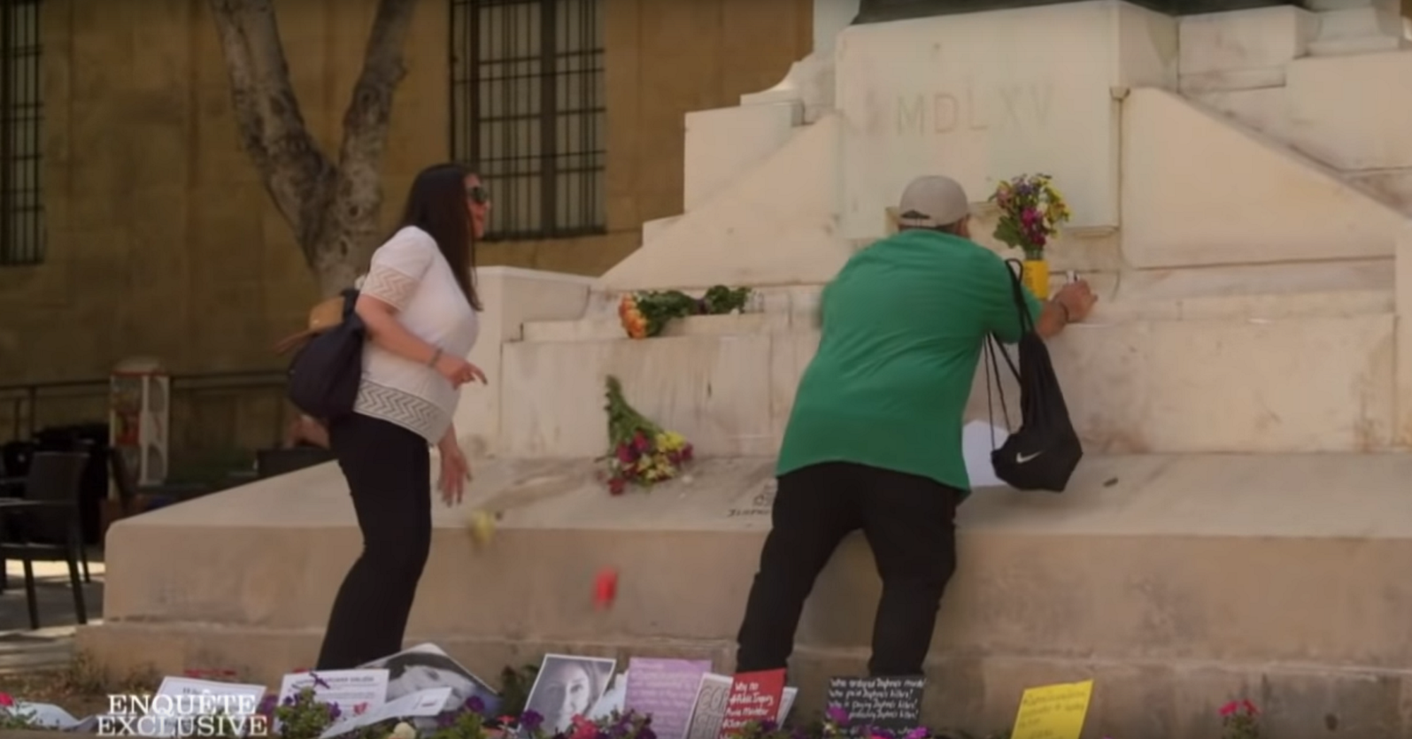 A man is filmed violently destroying a memorial to Daphne Caruana Galizia as her sister looks on in disbelief.