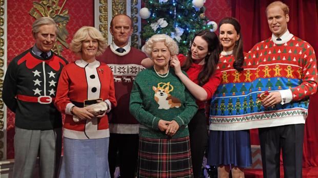 wax figures of the royal family have been dressed in christmas jumpers to help a childrens charity
