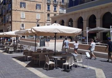 Tables and chairs on Merchants Street for Valletta's Suq