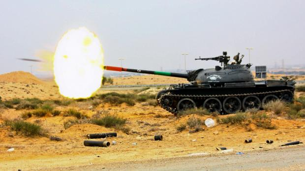 In this photo released by China's Xinhua News Agency, Libya's National Transitional Council tank fires at pro-Gaddafi militia during heavy battles in the western front lines of Sirte. Photo: Xinhua, Amru Salahuddien