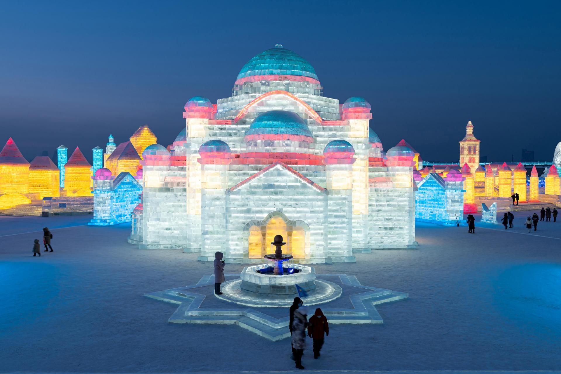 People look at ice sculptures at the Harbin Ice and Snow Festival in Harbin.