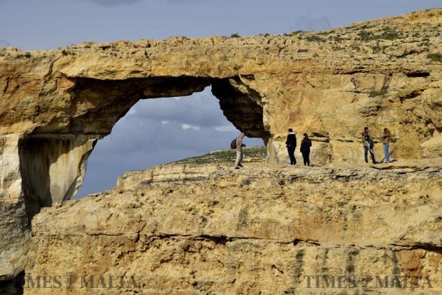 Tourists get close to take pictures of the Azure Window in Dwejra Gozo on January 11 Photo: Mark Zammit Cordina