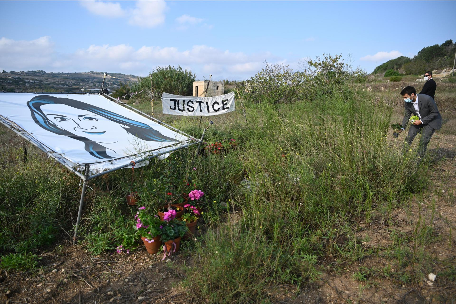 Family and friends lay flowers at the site of the murder of Daphne Caruana Galizia, three years on. Photo: Mark Zammit Cordina