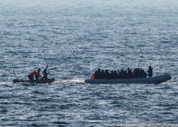 A Turkish coast guard about to strike the back of a migrant dinghy with 40 people on board. Photo: Jason Florio