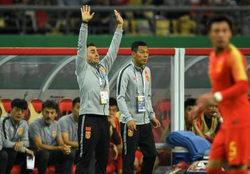 China's new head coach Fabio Cannavaro (left) gestures during the 2019 China Cup football match between China and Thailand.