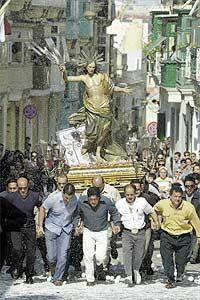 He is risen: The statue of the Risen Christ dashes forward under a shower of white paper strips and confetti in one of the narrow streets of Cospicua yesterday where the Easter Sunday celebration attracted large crowds. The statue was bought from Spain in 1741. Picture: Darrin Zammit Lupi.