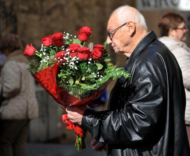 A man carries a bouquet of roses in Valletta's Republic Street on the eve of Valentine's Day on February 13. Photo: Chris Sant Fournier