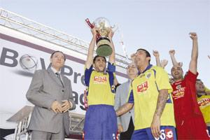 Marsaxlokk captain Carlo Mamo (left) lifts the BOV Premier League trophy to the delight of his team-mates and numerous fans. Photo: Darrin Zammit Lupi.