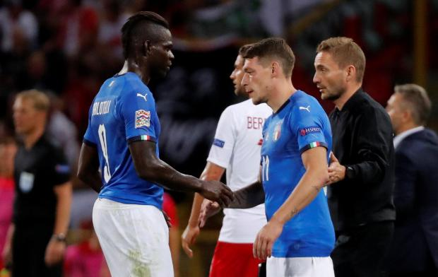 Mario Balotelli (left) is replaced by Andrea Belotti during the Nations League match against Poland.