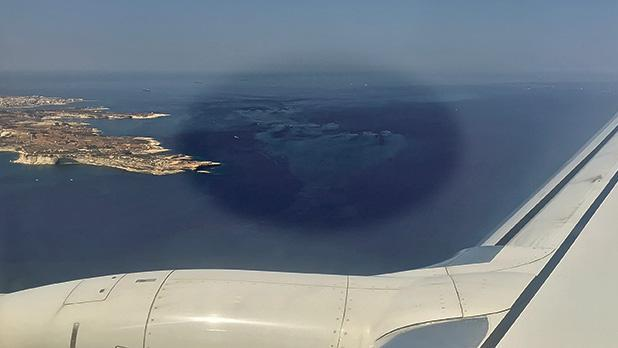 The massive spread of sludge believed to be from fish farms is seen clearly in this aerial shot above the south of Malta. Photo:Daniel Cilia.
