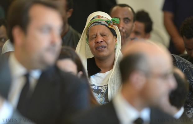 A woman cries during an inter-faith service for the twenty-four migrants who were among 850 feared dead in the Mediterranean at Mater Dei on April 23. Photo: Matthew Mirabelli